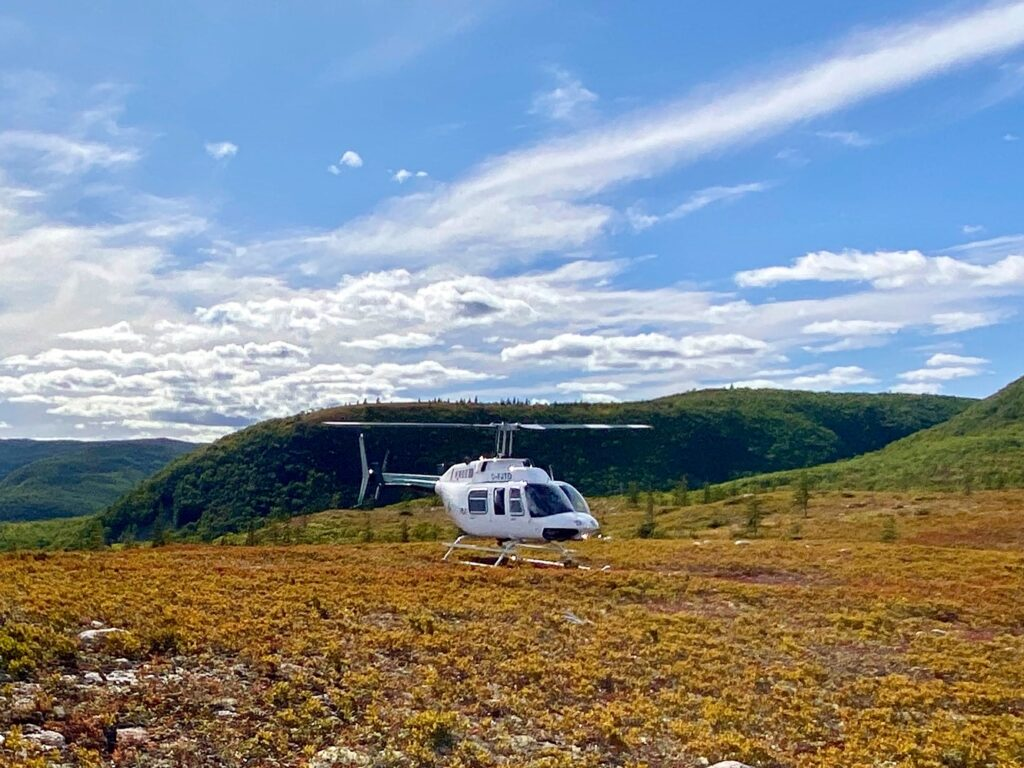 Breton Air Helicoptor awaiting take-off from a field in the Cape Breton Highlands